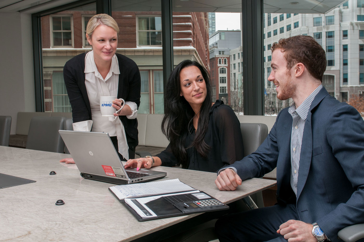 UMass graduates in a business setting