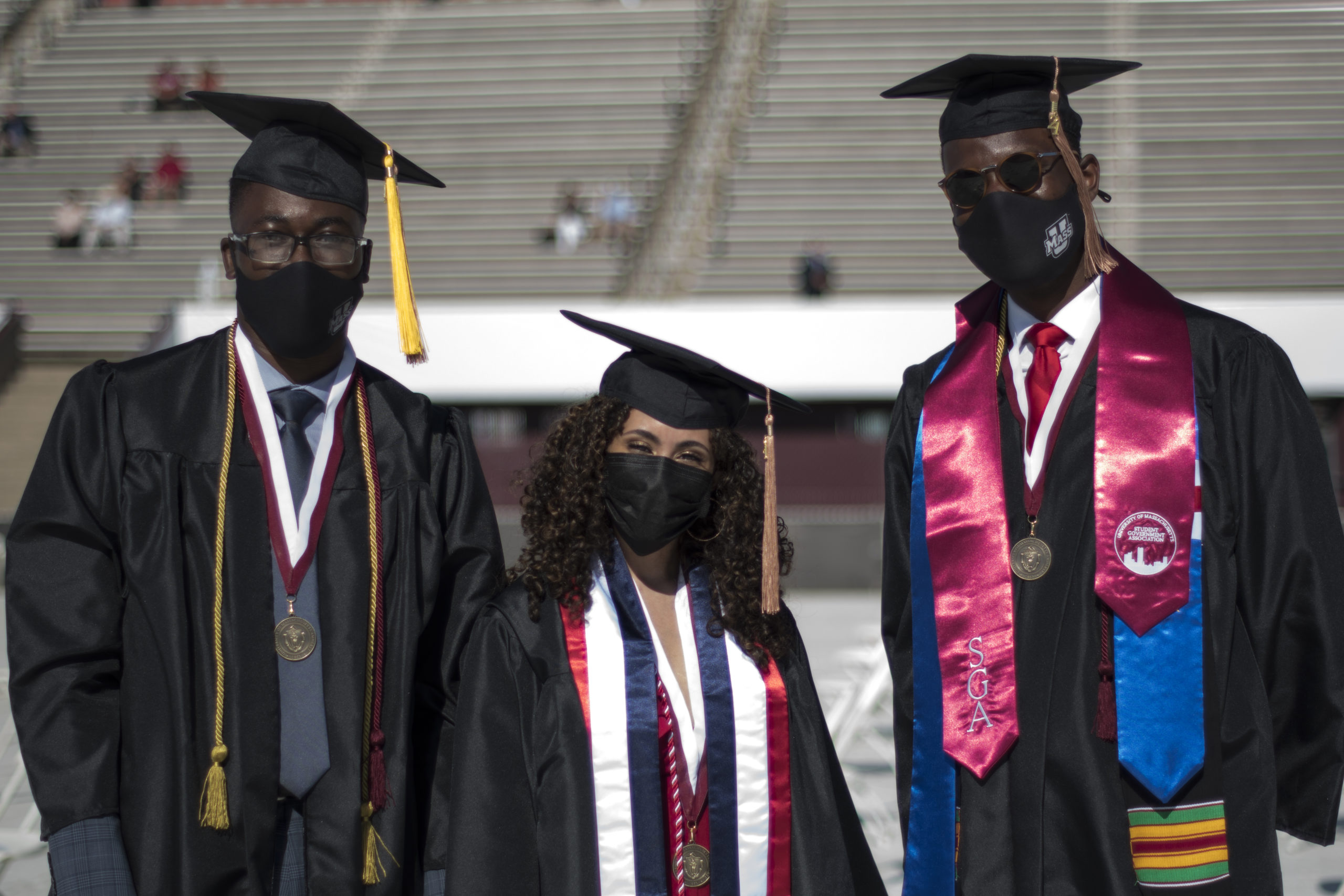 Three students wearing masks at UMass Amherst 2021 commencement ceremony